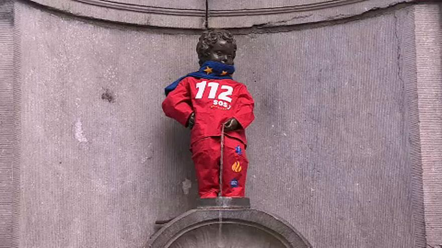 Manneken Pis dons European Emergency Number Association costume for 112 Day