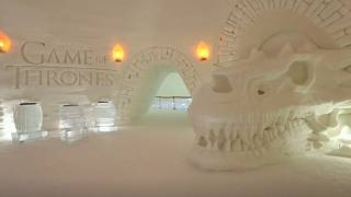 Snow sculptures including the army of the dead and dire wolves await guests