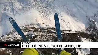 Daredevil base jumper performs outrageous leaps on Scottish mountains