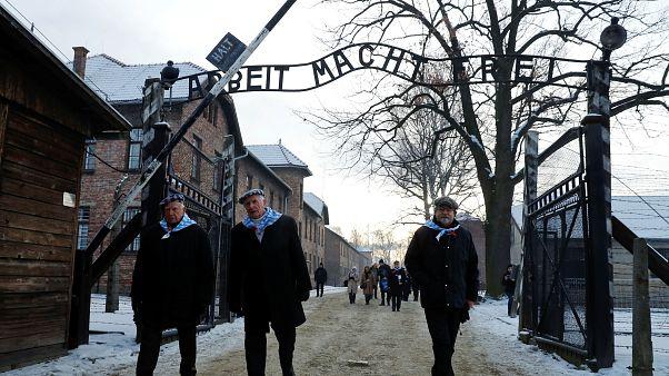 Holocaust survivors walking through the Auschwitz gates