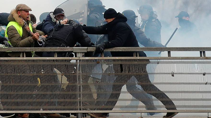 Former French boxing champion, Christophe Dettinger is seen during clashes