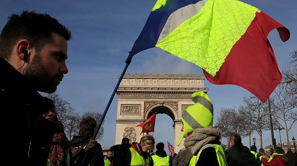 Protesters wearing yellow vests take part in a demonstration Feb 2019