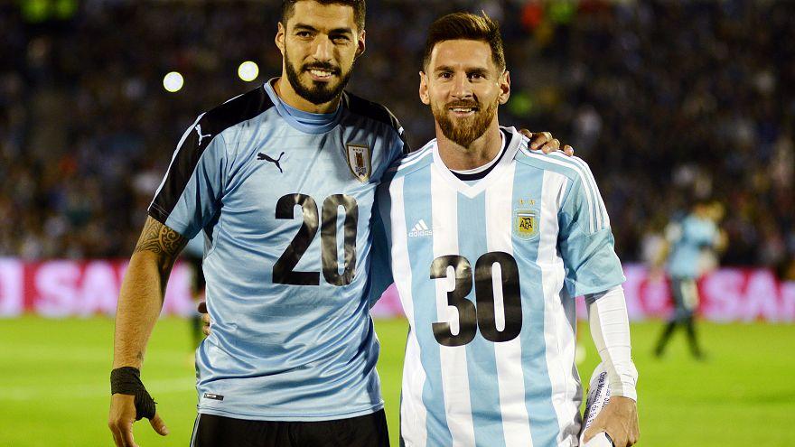 Argentina's Lionel Messi and Uruguay's Luis Suarez