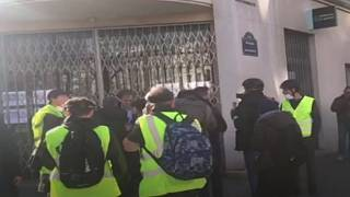 Finkielkraut is surrounded by Gilets Jaunes protesters in Paris on Saturday