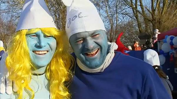 Participants of a bid to break the record for the largest Smurfs meeting