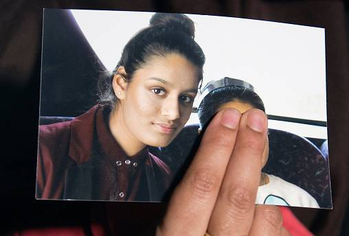 Renu Begum, sister of Shamima Begum, holds a photo of her sister.