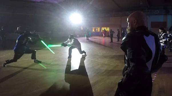 Duelling takes place in the dark with replica lightsabers