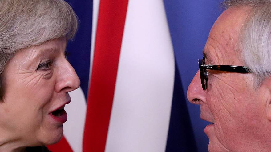 UK Prime Minister Theresa May with the EU's Jean-Claude Juncker