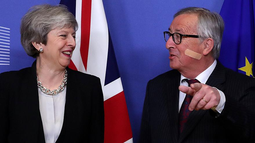 Theresa May and Jean-Claude Juncker share a joke ahead of Brexit talks