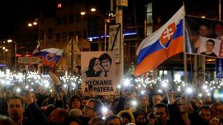 Demonstrators at a protest marking the anniversary of Kuciak's killing