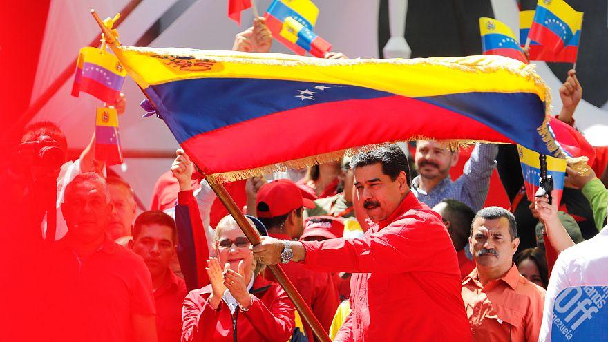 Maduro waves a Venezuelan flag