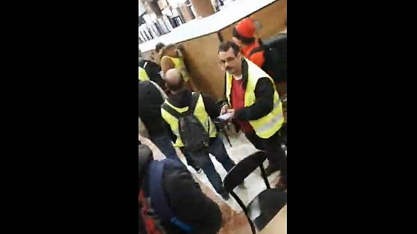 """Gilets jaunes"" take over Starbucks Coffee on Paris' Champs-Elysees"