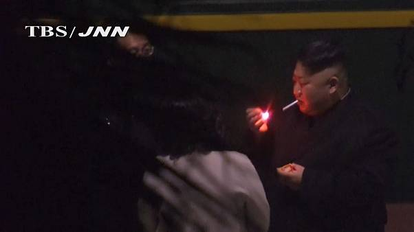 Kim Jong Un smoking at a Chinese Station