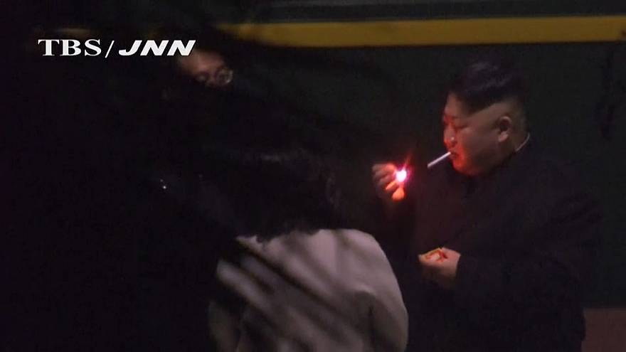 Kim Jong Un smoking at a Chinese Station