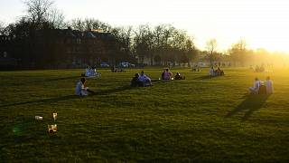 People make the most of the sun and warm weather as they sit in London