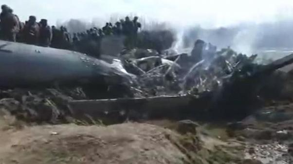 A screengrab of a Reuters video showing a crashed plane in Kashmir