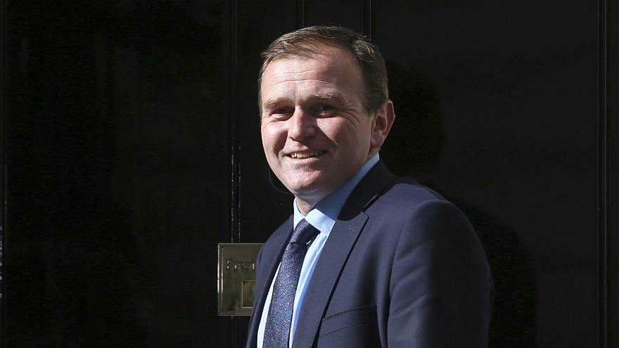 UK junior minister George Eustice resigns over possible Brexit delay