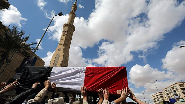 Mourners carry the body of an Egyptian officer killed in Sinai