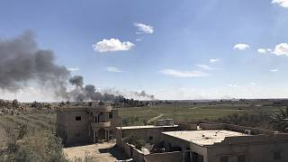 Black smoke rises from the last piece of territory held by ISIS in Syria