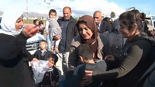 شاهد: نساء وأطفال أيزيدون يعودون للعراق بعد الأسر لسنوات لدى داعش