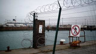 P&O cross-Channel ferry seen through razor wired security fence in Calais.