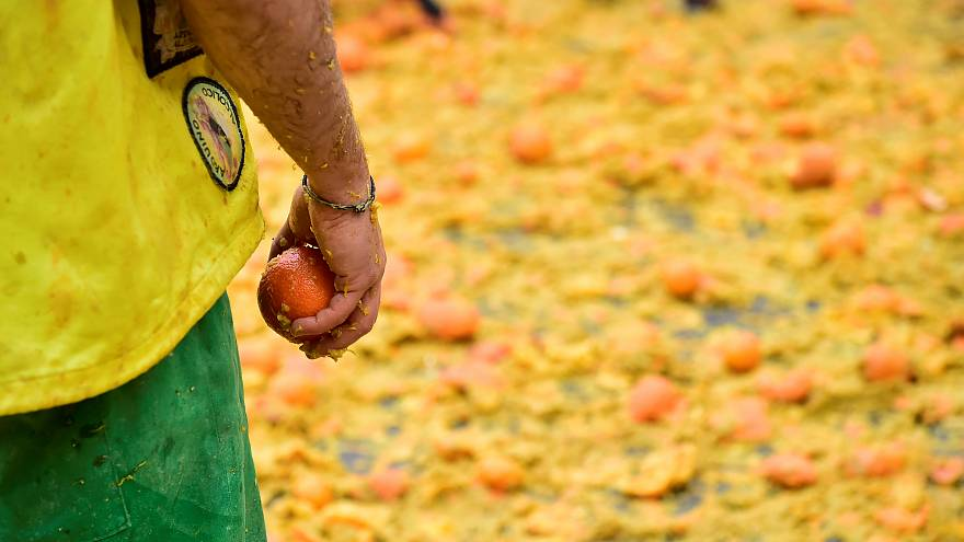Italians have massive fruit fight in annual Battle of the Oranges