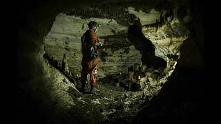 An archaeologist surveys the Balamku cave under Chichen Itza in Mexico