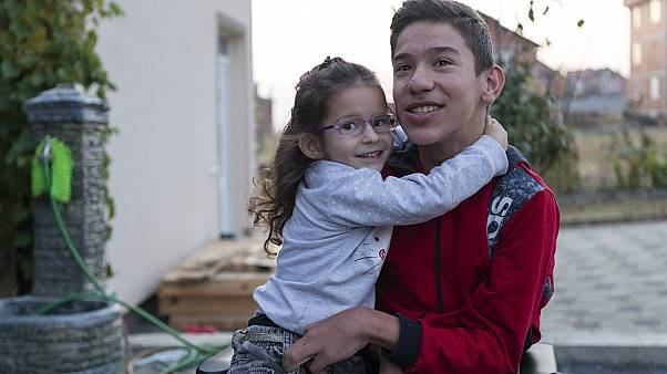 14-year-old Rijad Mehmeti, who has cerebal palsy, with his sister