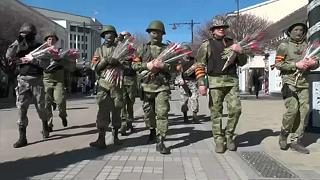 Crimea marks Women's Day with combat gear and flowers