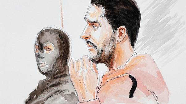 A court artist drawing shows Mehdi Nemmouche (right) during his trial.