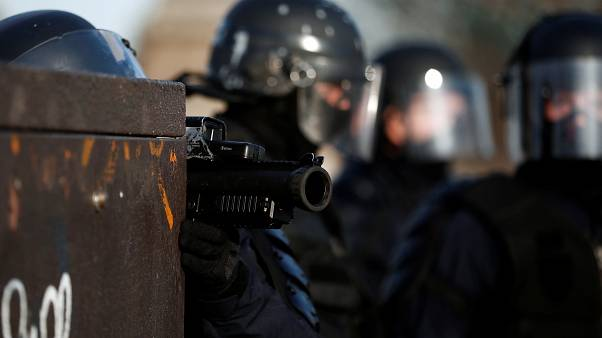 A French riot police officer holds a LDB-40 flashball in Paris in Feb 2019.