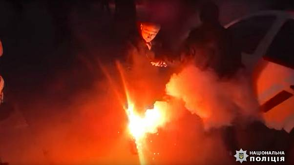 Ukrainian police officers injured in clash with far-right protesters at presidential event