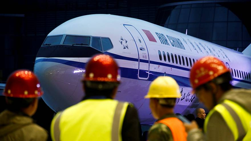 خلال مراسم تسليم دفعة من طائرة بوينغ 737 ماكس 8 إلى الصين