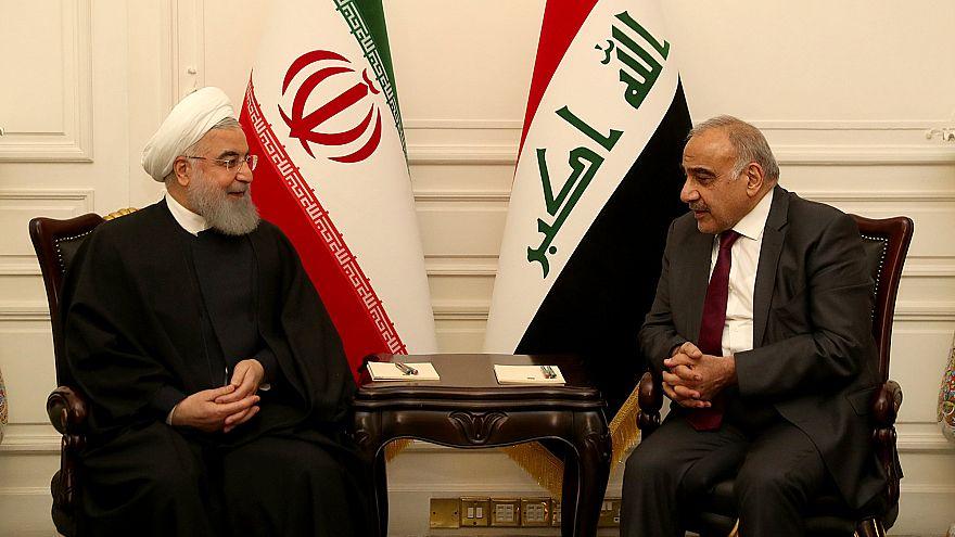 روحاني (يسار) بصحبة رئيس الوزراء العراقي عادل عبد المهدي