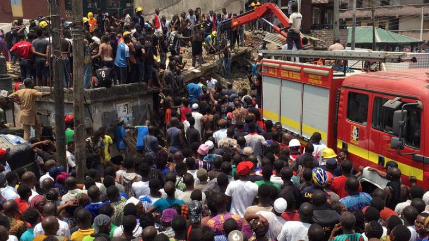 Rescue workers at the site of a collapsed building in Lagos, Nigeria