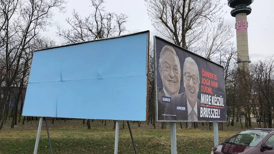 Hungary covers up some anti-EU posters during Manfred Weber's visit
