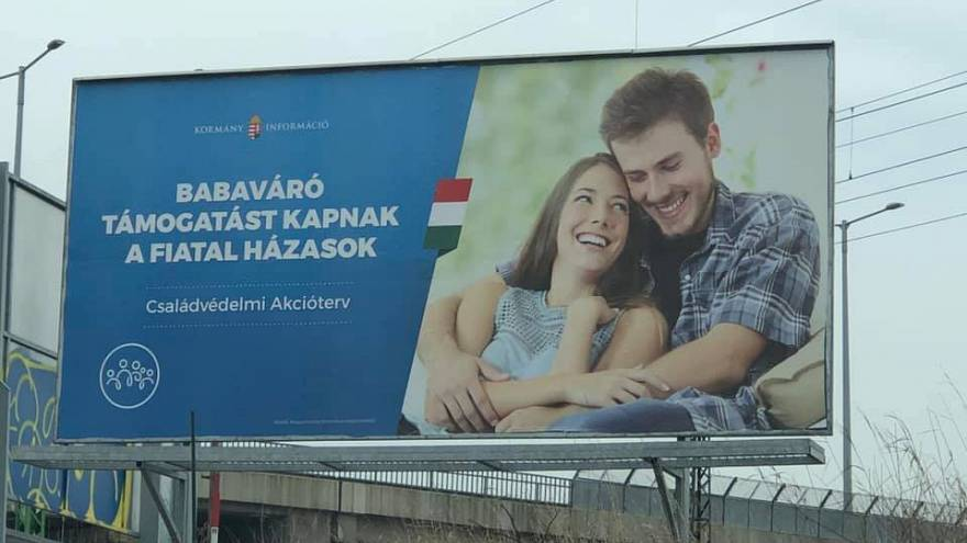 Hungarian government uses couple from 'unfaithful boyfriend meme' in billboard campaign