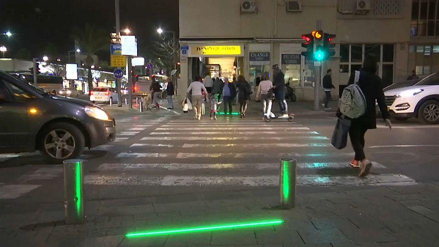 Tel Aviv installs 'zombie lights' for pedestrians addicted to mobile phones
