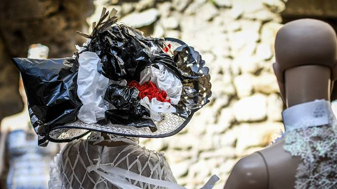 Eco-friendly designers create haute couture fashion out of trash