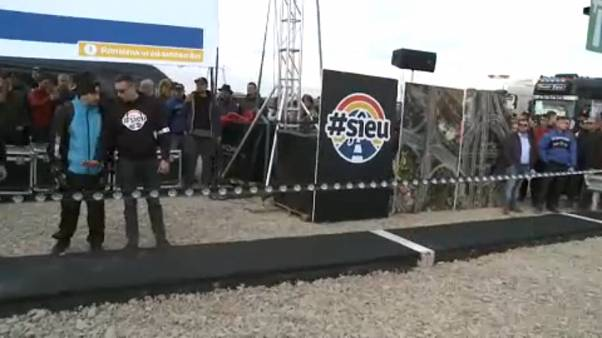 """Romanian protest leader builds a one metre """"motorway"""""""