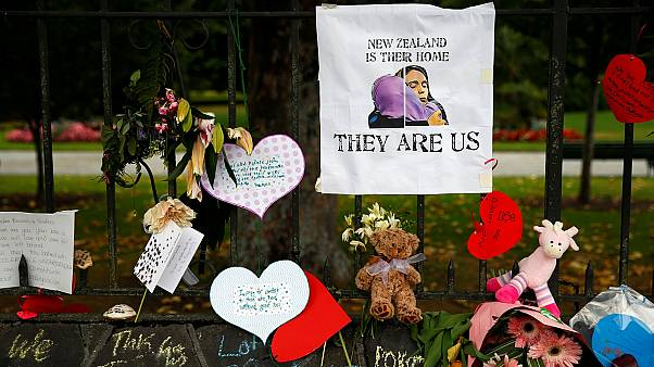Signs at a memorial site for victims of the Christchurch mosque shootings