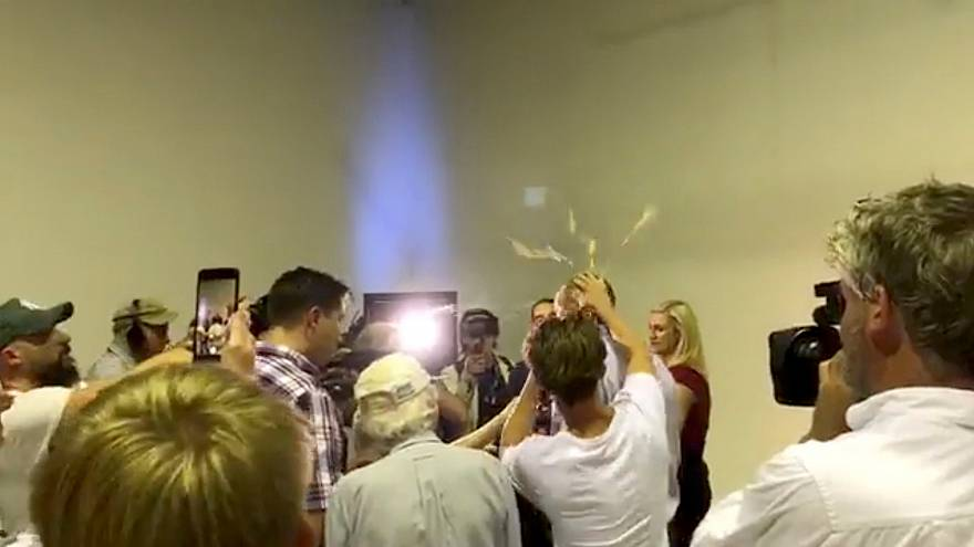 An egg is smashed over Fraser Anning's head