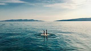 A primitive atoll lost in the shimmering blue sea of Croatia