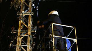 Nicolae Robu cutting telecommunications cables.