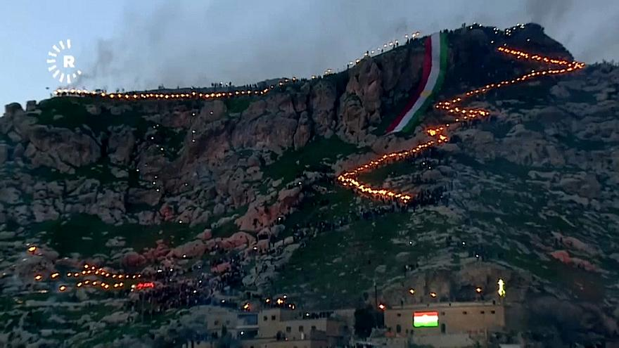 Thousands climbed the Akre mountain in a torchlit procession