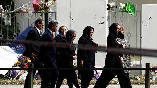 Jacinda Ardern walks past Al-Noor mosque as she arrives for Friday prayers