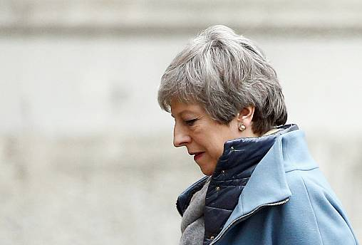 UK Prime Minister Theresa May returns to London from EU summit