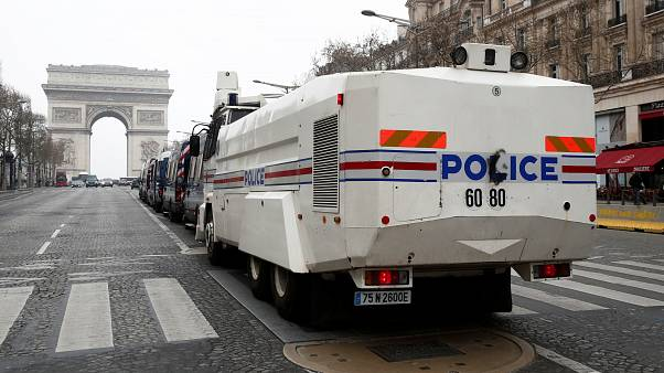 French police water canon vehicle is in place on the Champs-Elysees