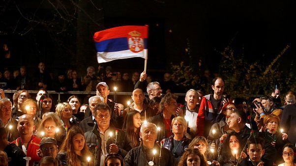 Demonstrators attend a protest against President Aleksandar Vucic