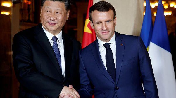 Le président français E. Macron avec le président chinois Xi Jinping